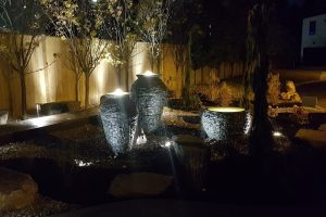 Modern landscape design in residential area at night